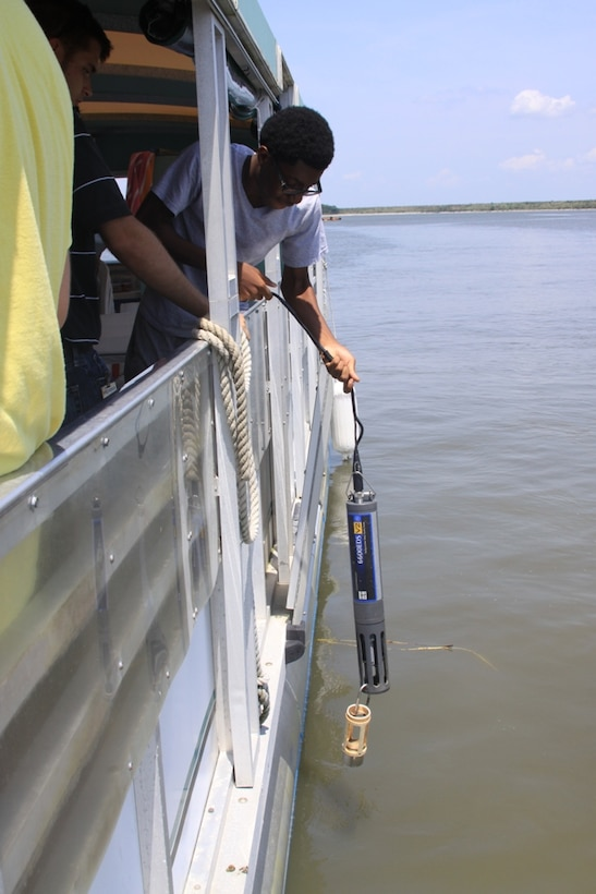 SAVANNAH, Ga. — A Jenkins High School student lowers a water quality probe into the Savannah Harbor during a boat tour hosted by the U.S. Army Corps of Engineers Savannah District, July 25, 2012.
