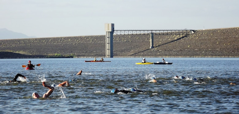 COCHITI LAKE, N.M., -- Cochiti Lake hosted portions of Chasing 3's Cochiti Lake Triathlon July 29, 2012.  Pictured here is the swimming portion of the race, with Cochiti Dam in the background.