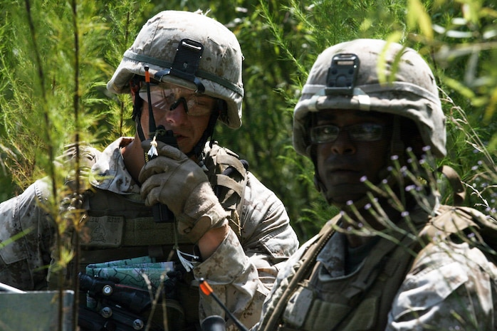 Cpl. Aaron Michaels (left), a squad leader with 2nd Battalion, 2nd Marine Regiment, 2nd Marine Division, radios in a faux improvised explosive device. Marines and sailors with Company E, 2nd Battalion, 2nd Marine Regiment, 2nd Marine Division, practiced counter-IED training July 30- August 2.