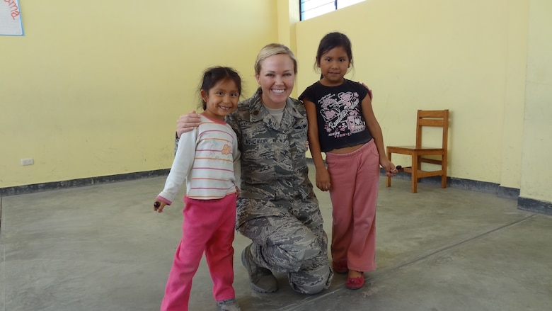 Maj. (Dr.) Wendi Wohltmann, 81st Diagnostics and Therapeutics Squadron, Keesler Air Force Base, Miss., poses for a photo with two Peruvian children July 21, 2012, during a medical readiness exercise in Peru. Wohltmann was one of seventeen 81st Medical Group members that participated in the exercise and humanitarian effort July 16-26.  (U.S. Air Force photo by Maj. Ronald Eller)