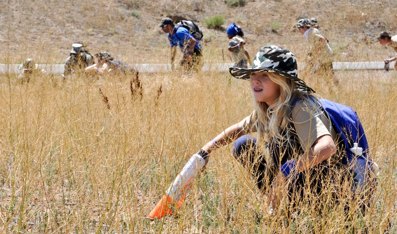 BUCKLEY AIR FORCE BASE, Colo. -- A child scouts ahead in order to protect her teammates during the mission portion of Operation Future Forces Aug. 4, 2012.  The children were required to maintain thier own security forces while they attempted to secure each of thier many objectives.  (U.S. Air Force photo by Staff Sgt. Nicholas Rau)
