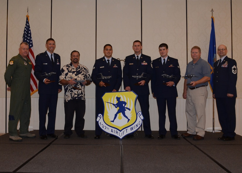 Col. Erik Hansen, 437th Airlift Wing commander (left), and Chief Master Sgt. Gerard Komen, 437th Maintenance Operations Squadron (right), congratulate the 437th Airlift Wing Second Quarter Award Winners after a ceremony at the Charleston Club at Joint Base Charleston – Air Base, Aug. 2, 2012 at JB Charleston, S.C. (left to right) Capt. Justin Berry, 16th Airlift Squadron Junior Company Grade Officer of the Quarter; Mr. Dennis Ingold, 437th Aerial Port Squadron, Civilian Category I of the Quarter; Senior Airman Kenneth Harris, 437th Aircraft Maintenance Squadron, Airman of the Quarter; Master Sergeant John Lipsey, 437th AMXS Senior Noncommissioned Officer in Charge of the Quarter; Senior Airman Daniel Godfrey, 437th APS, Volunteer of the Quarter; Andrew Branch, 437th APS, Civilian Category II of the Quarter. Not pictured are Tech. Sgt. Brian Higgins, 437th Operations Support Squadron, Noncommissioned Officer of the Quarter and Capt. Clark Grosvenor, 16th AS, Company Grade Officer of the Quarter. The winners were nominated by their supervisors for superior performance and hard work. (U.S. Air Force photo by Staff Sgt. Katie Gieratz)