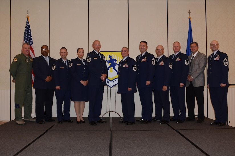Col. Erik Hansen, 437th Airlift Wing commander (left), and Chief Master Sgt. Gerard Komen, 437th Maintenance Operations Squadron (right), congratulate the 437th Airlift Wing Second Quarter Innovator Team Award Winners after a ceremony at the Charleston Club, Aug. 2, 2012 at Joint Base Charleston, S.C. (left to right) Lawrence Strother, 437th Aircraft Maintenance Squadron; Master Sgt. Glenn Hill, 437th Maintenance Operations Squadron; Tech. Sgt. Jonica Parker, 437th Maintenance Squadron; Master Sgt. Scott Kapanke, 437th MXS; Master Sgt. Gregory Milano, 437th AMXS; Senior Master Sgt. Daniel Small, 437th AMXS; Master Sgt. Paul Holland, 437th AMXS; Master Sgt. Matthew Koeln, 437th AMXS and Mark Gardner, 437th AMXS. Not pictured are Senior Master Sgt. Jayson Johnston, 315th AMXS; Master Sgt. Adam Morgan, 437th AMXS, Master Sgt. Dennis Wells, 437th AMXS; and Senior Airman Calli Marshall, 437th AMXS. The winners were nominated for creating a process which would include better coverage of maintenance support activities, increase quality of life, even the workload for all shifts and create more reliable work schedules for maintenance workers. (U.S. Air Force photo by Staff Sgt. Katie Gieratz)