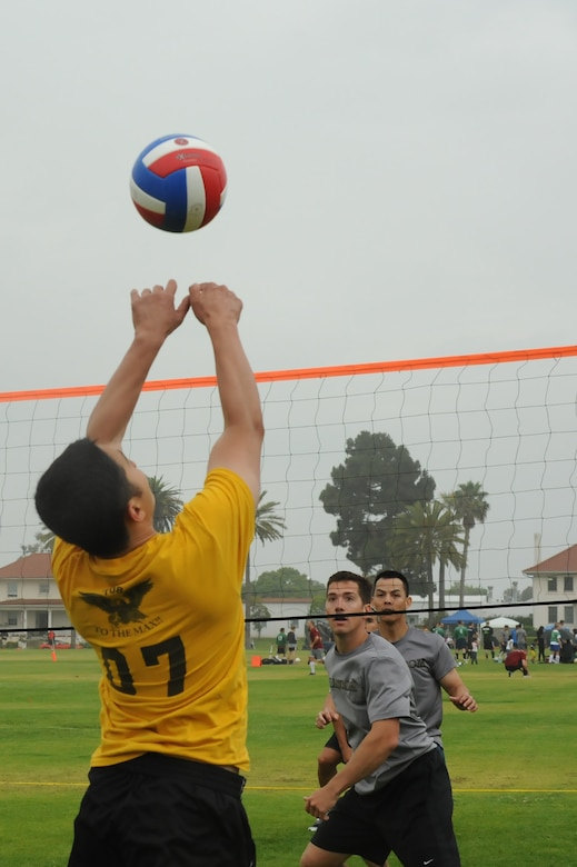 A player sets the ball during a volleyball game during SMC's annual Sports day, July 13.  The MILSATCOM Team won the volleyball tournament and this year's overall Sports Day crown. (Photo by Sarah Corrice)