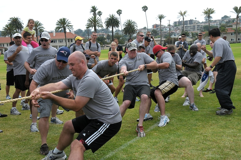 Members of the Military Satellite Systems Directed tug of war team are cheered on by the crowd during SMC Sports Day, July 13. MILSATCOM took the overall Sports Day title for the second year in a row. (Photo by Joe Juarez)