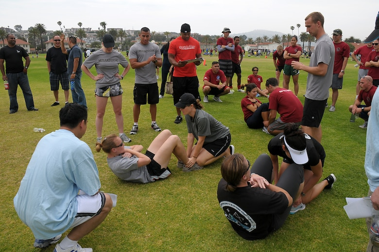 Competitors see who can do the most sit ups during the WARFIT challenge at SMC's annual Sports Day, July 13. (Photo by Joe Juarez)