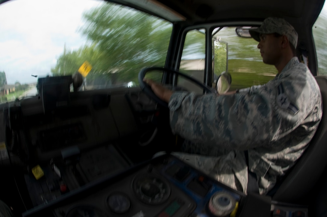 U.S. Air Force Airman 1st Class Salman Syed, a reservist pavement and construction heavy equipment operator from the 1st Special Operations Civil Engineering Squadron, drives a street sweeper on Independence Road, Hurlburt Field, Fla., Aug. 8, 2012. Street sweeping is an effective method of removing large debris that can block storm water facilities, causing localized flooding during heavy rains. (U.S. Air Force Photo/Airman 1st Class Hayden K. Hyatt)