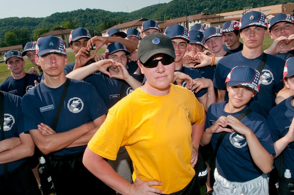 Master Sgt. Kelley McKinney, a trainer-advisor-counselor, or TAC, for the West Virginia National Guard's Youth Leaders Camp, is surrounded by her platoon at Camp Dawson, June 28, 2012. McKinney has been a TAC for the camp for six years. (Air National Guard photo by Master Sgt. Emily Beightol-Deyerle)