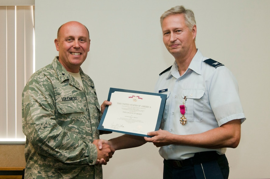 Brig. Gen. Eric Vollmecke presents Colonel Brian Truman with the Legion of Merit during Truman's retirement ceremony at the 167th Airlift Wing on August 5, 2012. Truman served the unit in several capacities including Wing vice commander before retiring after 33 years of service. (Air National Guard photo by Master Sgt. Emily Beightol-Deyerle)