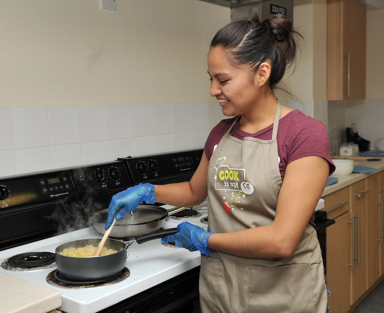 RAF MILDENHALL, England - Airman 1st Class Candyce Eaton, 100th Force Support Squadron, cooks egg noodles as part of the Cook It Up demonstration at a dormitory here August 7, 2012. The Bob Hope Community Center hosts several different types of programs here every month that are open to all DoD ID card holders. (U.S. Air Force photo/Senior Airman Jerilyn Quintanilla)