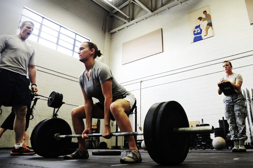 Tech Sgt. Amanda Helton, 1st Combat Camera Squadron broadcaster, performs a dead lift during a weightlifting test Aug. 3, 2012, at the fitness center at Joint Base Charleston - Air Base, S.C.  The weightlifting test included bench press, squats, dead lifts and pull-ups. The total amount each Airman lifted was divided by their body weight to give a pound-for-pound strength score in both the male and female categories.  The voluntary program was the first weight lifting test held by the 1st CTCS.  It was started by the unit's fitness monitors to motivate Airmen to diversify their workouts and show them the importance of incorporating strength training.  (U.S. Air Force photo/ Staff Sgt. Nicole Mickle)