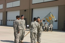 LTC Stamm entrusts the Guidon to CPT Giulitto.