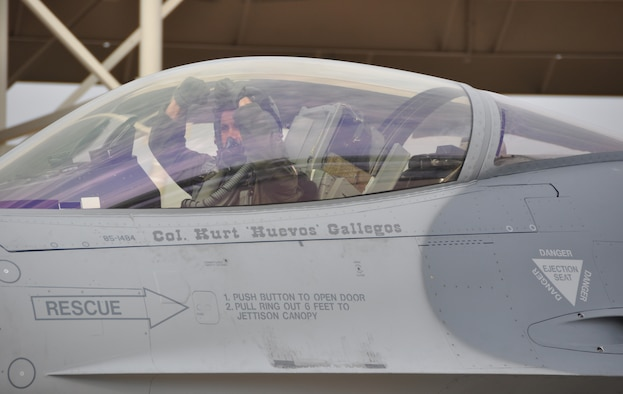 301st Operations Group Commander, Col. Kurt J. Gallegos taxies to the runway to begin the flight where he will achieve the milestone goal of flying more than 4000 hours in an F-16 Fighting Falcon Wednesday, Aug. 8, 2012. Reaching this point in his career, Gallegos joins a small group of pilots that currently hold this designation. On average, 4000 hours translates to 166 days in flight. His wingman for the occasion was none other than 10th Air Force Commander, Brig. Gen. William B. Binger. (U. S. Air Force photo/SrA Melissa Harvey)