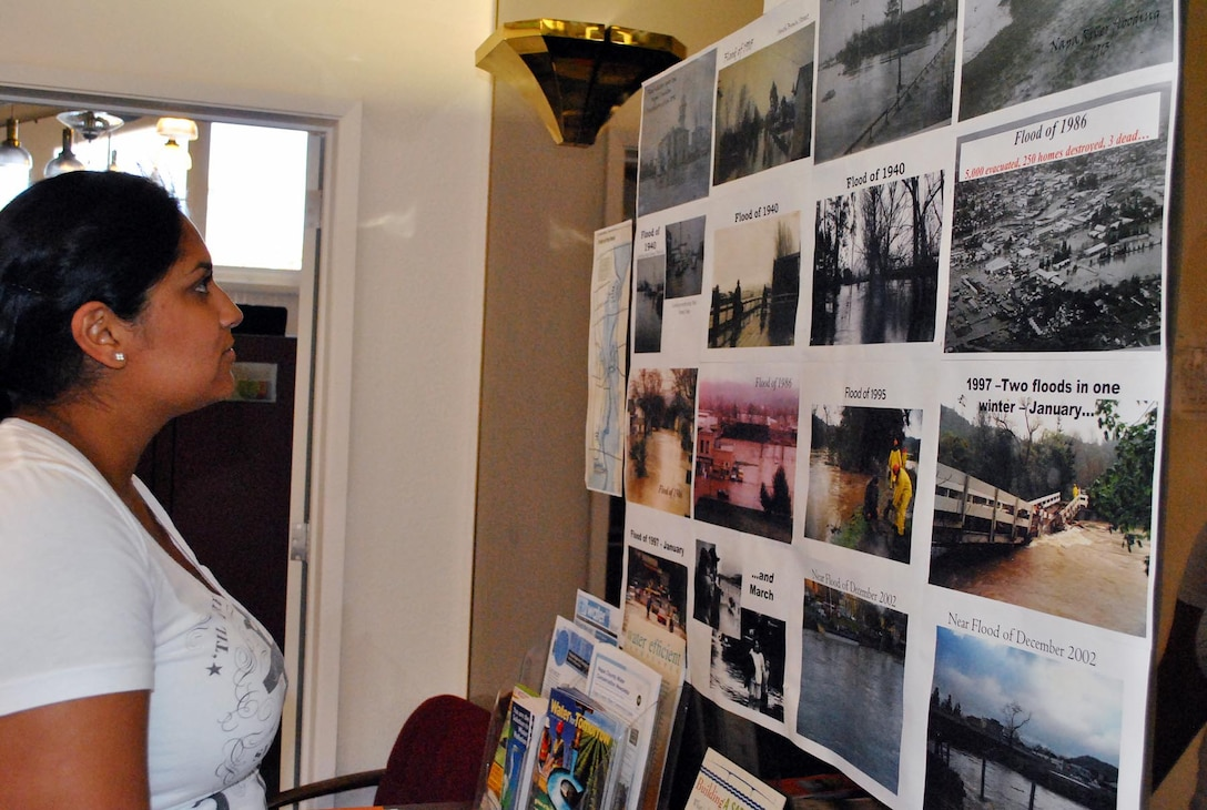 CALIFORNIA — Iris Chavez, a civil engineer with the U.S. Army Corps of Engineers San Francisco District looks at historic photographs of flooding in Napa. Chavez is one of the personnel overseeing construction of a project that will reduce the risk of flooding in the area. As a Napa resident herself, she is excited about the benefits the project will bring for her community, she said.