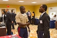 Capt. Adesina Aladetohun, officer selection officer, Recruiting Station Baton Rouge, speaks to a law student at the 2012 National Black Prosecutors Association job fair at the Roosevelt Hotel, July 31. Marines attended the NBPA's annual convention and job fair to establish relationships with community leaders and prospect for potential Marine officers among the law students in attendance.