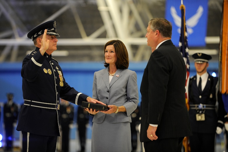 Secretary of the Air Force Michael Donley swears in Gen. Mark A. Welsh III as the 20th Air Force chief of staff, assisted by Welsh's wife, Betty, during a ceremony at Joint Base Andrews, Md., Aug. 10, 2012. (U.S. Air Force photo/Scott M. Ash)