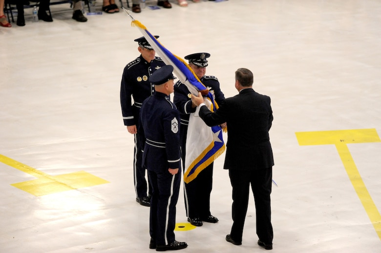 Secretary of the Air Force Michael Donley passes the chief of staff flag to Gen. Mark A. Welsh III during a ceremony at Joint Base Andrews, Md., Aug. 10, 2012. Prior to his new position, Welsh was the commander of U.S. Air Forces in Europe. (U.S. Air Force photo/Master Sgt. Cecilio Ricardo)