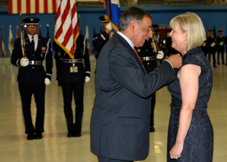 Secretary of Defense Leon Panetta awards Suzie Schwartz, wife of former Air Force Chief of Staff Gen. Norton Schwartz, with the Distinguished Public Service Award on the occasion of Schwartz's retirement during a ceremony at Joint Base Andrews, Md., Aug. 10, 2012.  Schwartz served as Air Force chief of staff for four years and was succeeded by Gen. Mark A. Welsh III.  Welsh previously commanded U.S. Air Forces in Europe.  (U.S. Air Force photo/Michael J. Pausic)