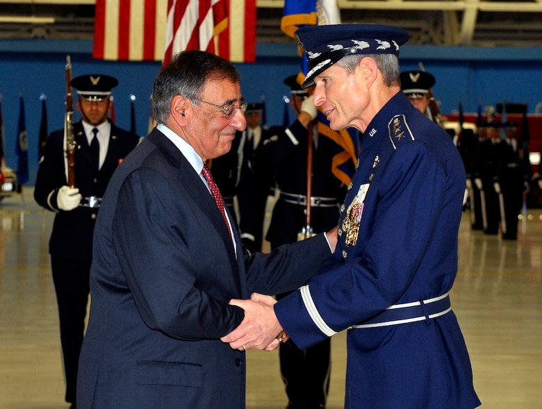 Secretary of Defense Leon Panetta congratulates Gen. Norton Schwartz on the occasion of his retirement during a ceremony at Joint Base Andrews, Md., Aug. 10, 2012.  Schwartz served as Air Force chief of staff for four years and was succeeded by Gen. Mark A. Welsh III.  Welsh previously commanded U.S. Air Forces in Europe.  (U.S. Air Force photo/Michael J. Pausic)