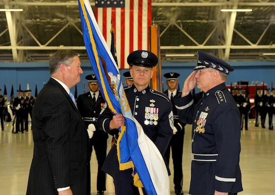 Secretary of the Air Force Michael Donley passes the chief of staff flag to Gen. Mark A. Welsh III during a ceremony at Joint Base Andrews, Md., Aug. 10, 2012. Prior to his new position, Welsh was the commander of U. S. Air Forces in Europe. (U.S. Air Force photo/ Michael J. Pausic)
