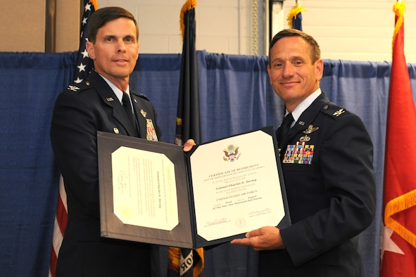 Col. Charles Dorsey (right), retiring 174th Fighter Wing Vice Commander, receives the Legion of Merit medal from Col. Greg Semmel, 174 FW Commander, during a ceremony held on 2 August 2012 at Hancock Field Air National Guard Base, Syracuse, New York. Col. Dorsey retired after 29 years of distinguished service in the U.S. Air Force. (New York Air National Guard photo by Tech. Sgt. Jeremy Call/Released)