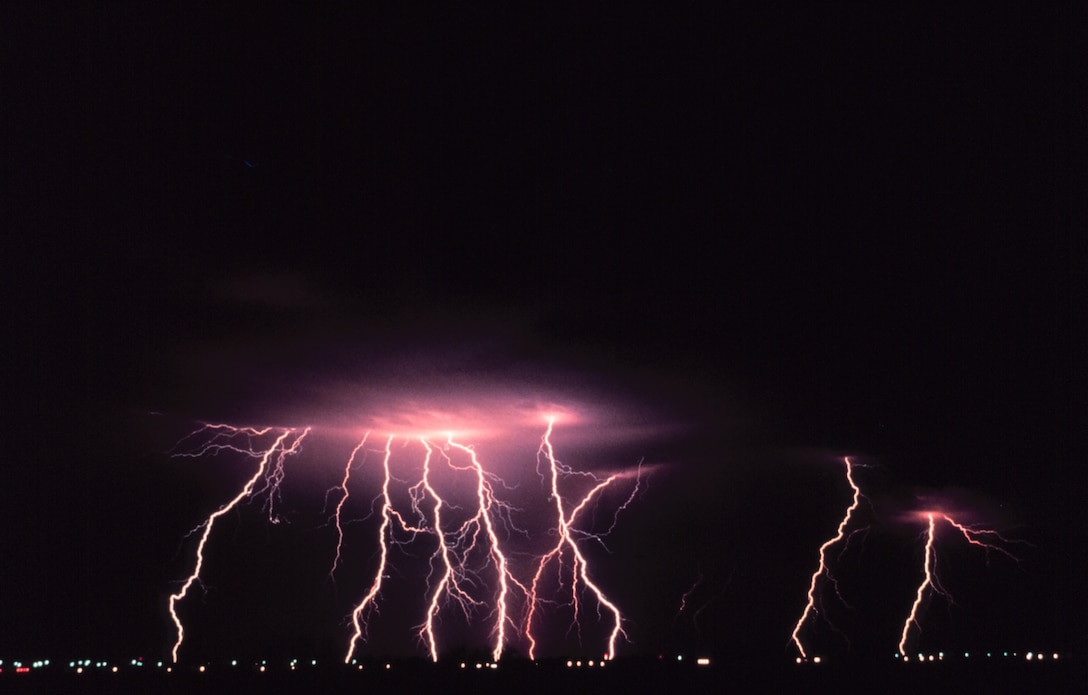 Time-lapse photography captures multiple cloud-to-ground lightning strokes during a night-time thunderstorm.  (Photo courtesy of the National Severe Storms Laboratory)