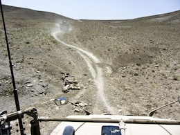 KANDAHAR PROVINCE, Afghanistan — A view of the way ahead, taken from the gunner's turret on an M-ATV, shows the difficult terrain that the column had to move through. David Nishimura and Sgt. 1st Class Gary Malkin, of the 565th Engineer Detachment (FEST-A), conducted a route reconnaissance mission in Shah Wali Kot district, Kandahar province, Afghanistan, on July 26, 2012.