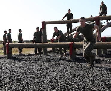 Officer candidates from Recruiting Station Orange County tackle the obstacle course on Marine Corps Base Camp Pendleton, Calif., April 14. The candidates completed training and classes during the day to keep their knowledge sharp before completing Officer Candidate School.