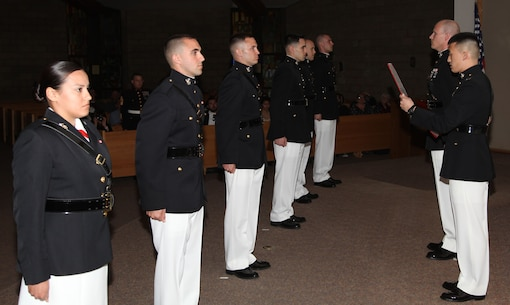 Capt. David Hankle reads the commissioning warrant for officer candidates at Marine Corps Base Camp Pendleton, Calif., April 14. The candidates, recruited out of Recruiting Station Orange County, completed Officer Candidate School and attained the rank of second lieutenant.