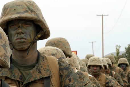 Pfc. Thomas S. Breiter, Platoon 1073, Company D, 1st Recruit Training Battalion, awaits improvised explosive device training alongside fellow Marines during the crucible at Marine Corps Base Camp Pendleton, Calif., June 12. Breiter chose to enlist into the Marines as military police, the same military occupational specialty as his mother. Breiter explained his choice to choose the Marine Corps over other military branches was highly influenced by his mother and father's service in the Corps.