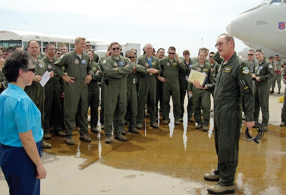 Surrounded by other crewmembers, family and friends, Maj. Jon Williams, 963rd Airborne Air Control Squadron, celebrates his final flight on the E-3 Sentry after 33 years of service in the United States Air Force and 10, 527.2 flying hours. (Air Force photo by Margo Wright)