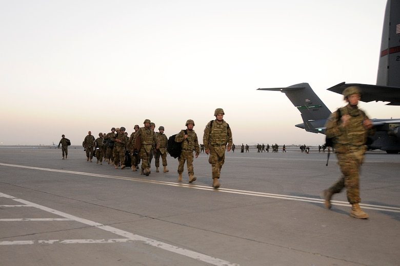 Airmen from the Minnesota Air National Guard disembark a C-17 on the ramp at Kandahar Airfield, Afghanistan, on Aug. 10, 2012. Personnel are deployed from the Minnesota Air National Guard's 148th Fighter Wing in support of Operation Enduring Freedom. Bull Dog F-16's, pilots, and support personnel began their Air Expeditionary Force deployment in mid-August to take over flying missions for the air tasking order and provide close air support for troops on the ground in Afghanistan.  (Air Force photo by Tech. Sgt. Stephen Hudson, 169th Fighter Wing/Public Affairs.)