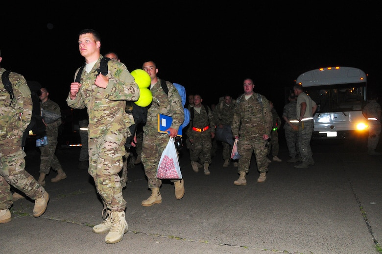 Members of the 148th Fighter Wing are transported by bus to an aircraft waiting to take them to Kandahar Air Field, Afghanistan on Saturday Aug. 11, 2012.  This marks the 148th's first deployment with the Block 50 F-16, as well as the first aviation package deployment to Afghanistan.  (National Guard photo by Tech. Sgt. Scott G. Herrington.)