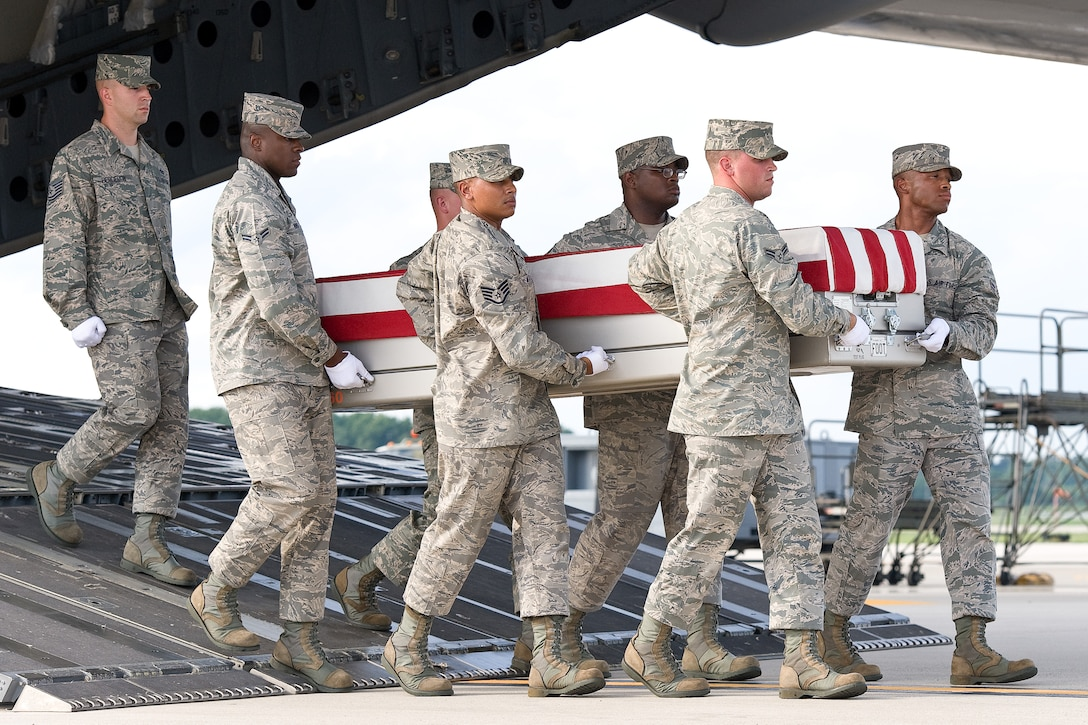 A U.S. Air Force carry team transfers the remains of Maj. Walter D. Gray, of Conyers, Ga., at Dover Air Force Base, Del., Aug. 10, 2012. Gray was assigned to the 13th Air Support Operations Squadron, Fort Carson, Colo. (U.S. Air Force photo/Roland Balik)