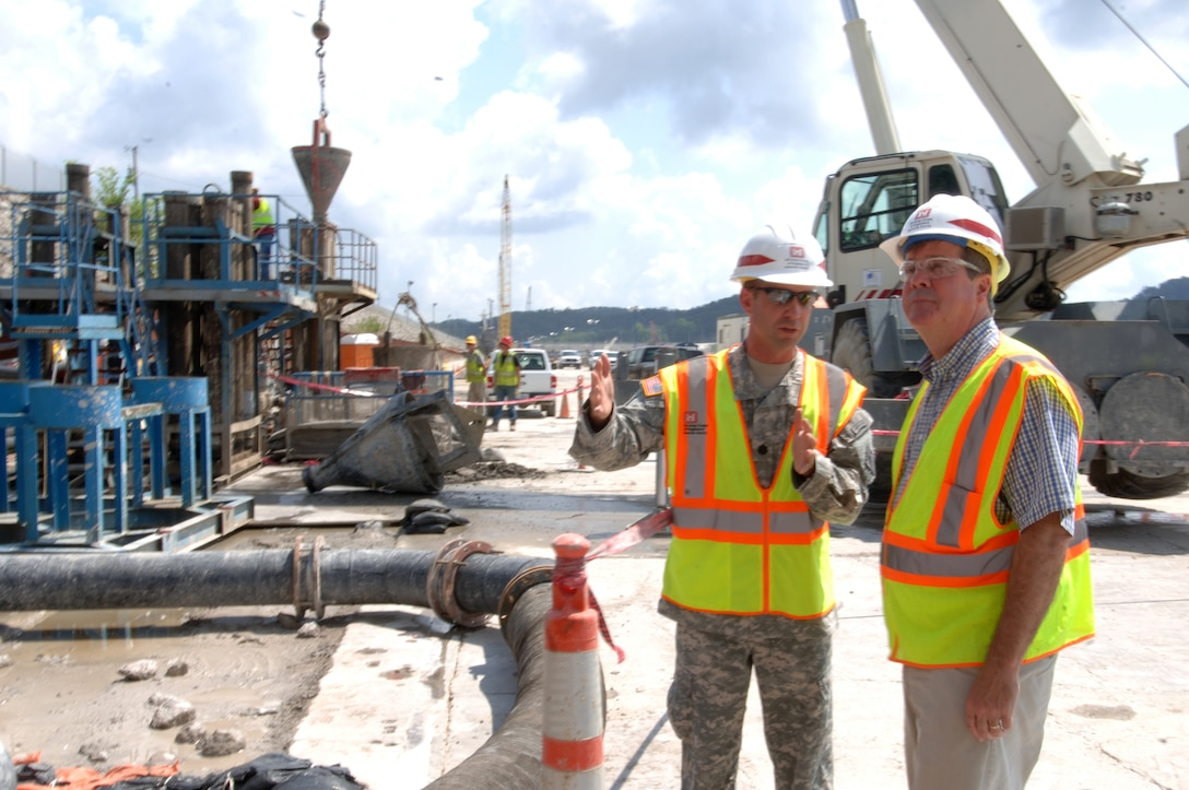 JAMESTOWN, Ky. — Lt. Col. James A. DeLapp, U.S. Army Corps of Engineers Nashville District commander, leads Nashville Mayor Karl Dean on a tour of the work platform at Wolf Creek Dam Aug. 7, 2012 where construction is ongoing to install a barrier wall through the embankment deep into bedrock below the foundation.