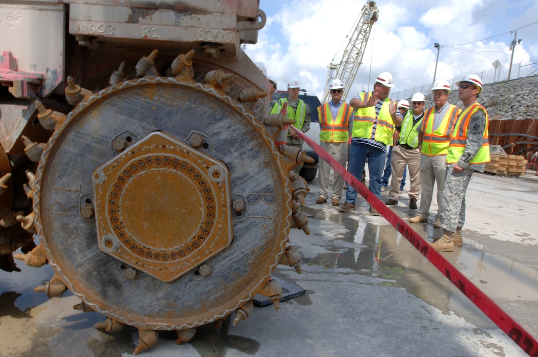 JAMESTOWN, Ky. — A tour group with Nashville Mayor Karl Dean looks at a hydromill on the work platform at Wolf Creek Dam in Jamestown, Ky., Aug. 7, 2012. The U.S. Army Corps of Engineers Nashville District is installing a barrier wall through the dam's embankment into the hard bedrock to stop seepage through the karst geology.