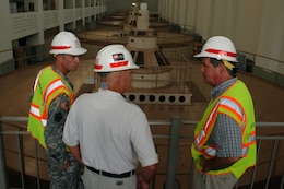 JAMESTOWN, Ky. — Larry Craig (center), U.S. Army Corps of Engineers Nashville District power project manager, leads Nashville Mayor Karl Dean (right) and Lt. Col. James A. DeLapp, Nashville District commander, on a tour of the Wolf Creek Dam Hydropower Plant Aug. 7, 201