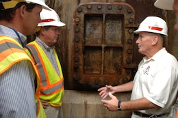 JAMESTOWN, Ky. — Larry Craig (right), U.S. Army Corps of Engineers Nashville District power project manager, leads Nashville Mayor Karl Dean (center) and Scott Potter, director of Nashville's Metro Water Services, on a tour of the Wolf Creek Dam Hydropower Plant Aug. 7, 2012