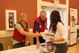 A military spouse speaks to a potential employer at the Marston Pavilion aboard Marine Corps Base Camp Lejeune during the Military Spouse Business Alliance Hiring Fair and Career Forum Aug. 9. There were approximately 30 employers for the more than 400 job-seekers present.