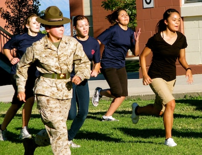 SSgt Carolina Andrade leads female poolees from RSS Provo in a series of exercises during the Utah State Wide Poolee Competition at RSS Provo on July 27. The poolees had to complete various exercises against each other while drill instructors gave them proper motivation.