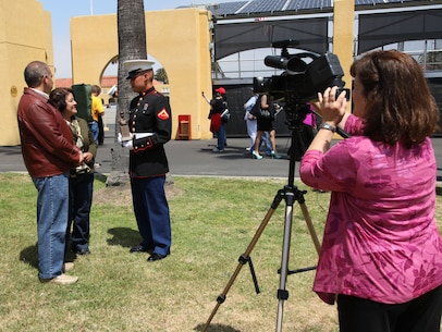 Lance Cpl. Oziel Camacho and his parents are interviewed by Judy Chauncey at Marine Corps Recruit Depot San Diego, CA, on April 20. Camacho was the honor graduate for Fox Company, and just graduated from boot camp. Camacho was recruited out of Mission Viejo, Calif., by Sgt. Jeffrey Jewett Jr.
