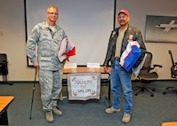 Tech. Sgt. Lawrence Bredwell (left) and retired Army Sgt.1st Class Christopher Chebahtah were both presented with Quilts of Valor during a presentation ceremony Aug. 8 at Building 2800. The Quilts of Valor Foundation is a foundation that presents quilts to servicemembers and veterans as a way of paying tribute and honoring those servicemembers. Bredwell is currently a fighter aircraft crew chief with the 31st Test and Evaluation Squadron and Mr. Chebahtah is an electrical technician with the 412th Maintenance Group Bomber Instrumentation shop. (U.S. Air Force photo by Jet Fabara)