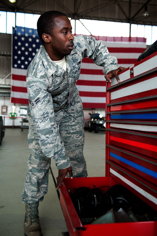 SPANGDAHLEM AIR BASE, Germany – Airman 1st Class Joshua Green, 81st Aircraft Maintenance Unit weapons load crew member, closes a toolbox drawer during a weapons load competition here Aug. 10.  The 480th and 81st AMUs host and participate in the timed competition once a quarter to see which unit has the fastest and most efficient weapons load crew.  The winners of the competition earn bragging rights as the best crew and a trophy. (U.S. Air Force photo by Airman 1st Class Gustavo Castillo/Released)