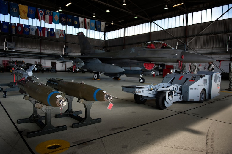 SPANGDAHLEM AIR BASE, Germany – An F-16 Fighting Falcon is parked in a hangar during a weapons load competition here Aug. 10.  The 480th and 81st AMUs host and participate in the timed competition once a quarter to see which unit has the fastest and most efficient weapons load crew.  The winners of the competition earn bragging rights as the best crew and a trophy. (U.S. Air Force photo by Airman 1st Class Gustavo Castillo/Released)