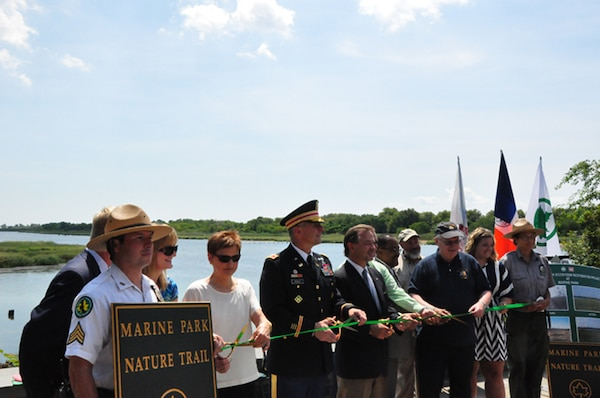 Representatives from the Army Corps of Engineers, New York District, and the New York City Department of Parks took part in a ribbon cutting ceremony to commemorate the completion of the Gerritsen Creek eco-system restoration project.