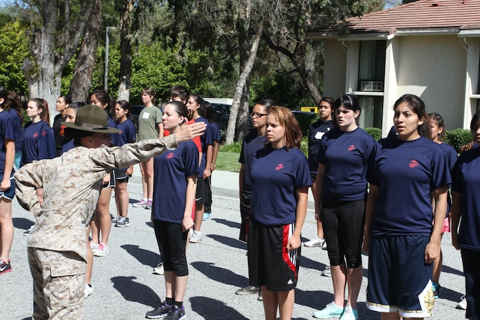 Drill Instructor Sgt. Rebecca Jones, 4th Recruit Training Battalion, Marine Corps Recruit Depot Parris Island, corrects a poolee at the Female Poolee Function here March 28. Poolees learned about recruit training, drill and ceremony and Marine Corps knowledge at the event