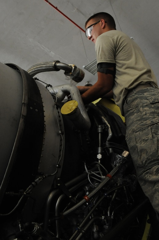 Senior Airman Colton Chandler, 2nd Maintenance Squadron aerospace propulsion craftsman, installs an air duct for a TF33/P-103 turbofan engine on Barksdale Air Force Base, La., Aug. 13. When a refurbished engine arrives from the Maintenance Depot at Tinker AFB, Okla., propulsion Airmen must install key components so the engine is ready to be mounted on a B-52H Stratofortress when needed. (U.S. Air Force photo/Airman 1st Class Micaiah Anthony)(RELEASED)