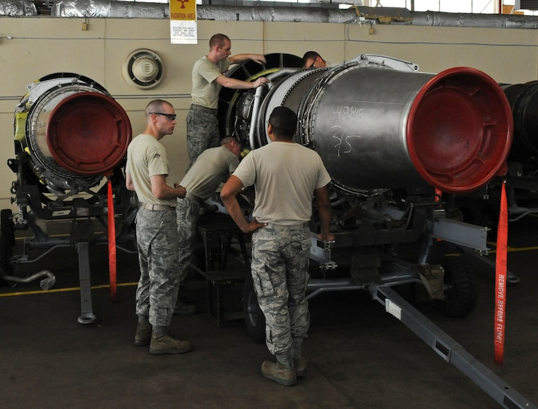 Airmen from the 2nd Maintenance Squadron Propulsion Flight work on a TF33/P-103 turbofan engine on Barksdale Air Force Base, La., Aug. 13. The engine was shipped from the Maintenance Depot at Tinker AFB, Okla., where all TF33/P-103 turbofan engines go for scheduled and major maintenance. The B-52H Stratofortress uses eight TF33/P-103 turbofan engines, each capable of producing 17,000 pounds of thrust.  (U.S. Air Force photo/Airman 1st Class Micaiah Anthony)(RELEASED)