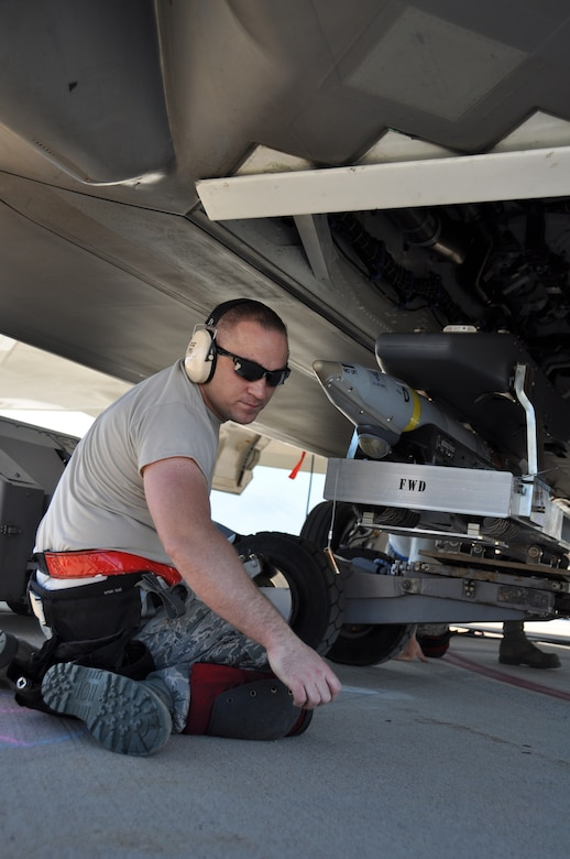 Staff Sgt. Brandon Vice, 477th Aircraft Maintenance Squadron weapons load crew member, guides a GBU-39 small diameter bomb into the main weapons bay of an F-22 during Combat Hammer. Combat Hammer is a weapons system evaluation program sponsored by the 86th Fighter Weapons Squadron, which provides an opportunity for an operational unit to employ them in a realistic tactical training environment.  (U.S. Air Force Photo/Tech. Sgt. Dana Rosso)