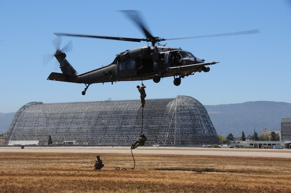 California Air National Guard pararescuemen, assigned to the 131st Rescue Squadron conduct a fast rope egress from an HH-60G Pave Hawk rescue helicopter, Moffett Federal Airfield, Calif., Aug. 8, 2012. This training is being conducted in conjunction with a cadet orientation flight and aircraft profile sensor data collection.  (Air National Guard photo by Staff Sgt. Kim Ramirez/RELEASED)